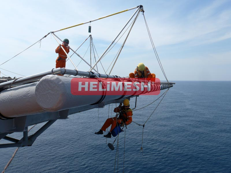 Helimesh-being-installed-by-crew-hanging